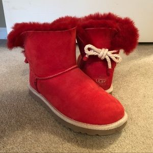 Red UGGS with a tan bow in the back.